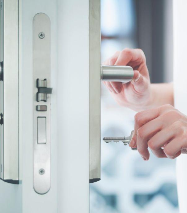 locking-or-unlocking-door-with-key-in-hand